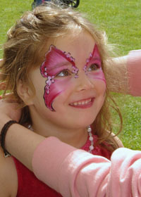 girl face-painted as flowery butterfly